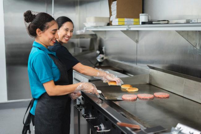 DoorDash Kitchens cooks making burgers