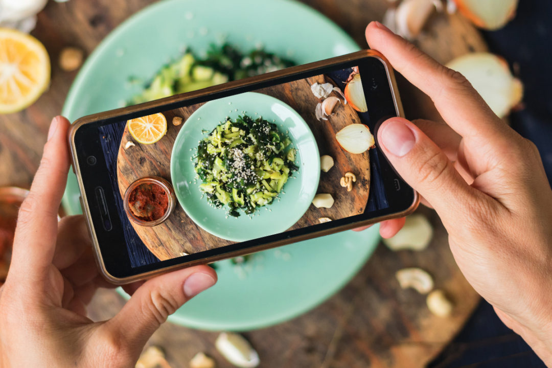 Taking photo of vegetarian meal with phone