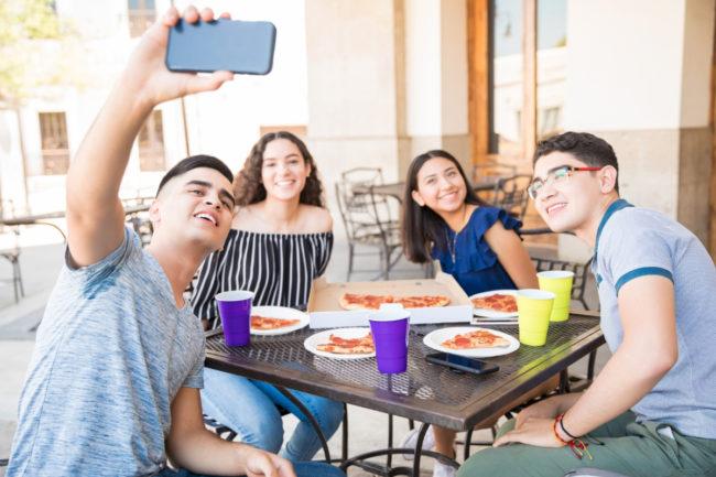 Gen Z teens eating at a restaurant