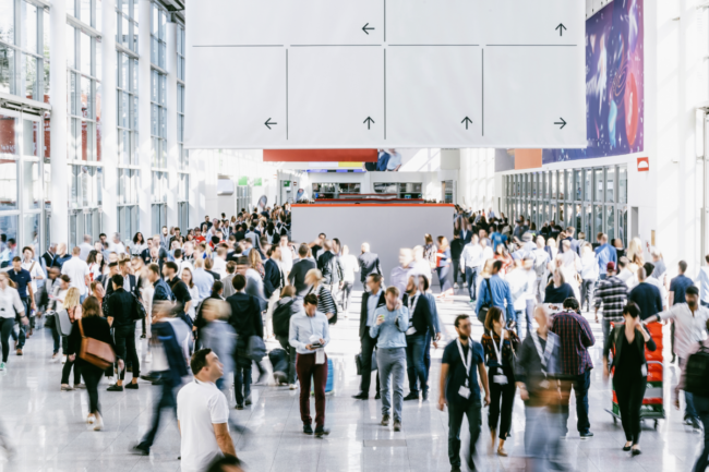 Crowd of people walking on a trade show