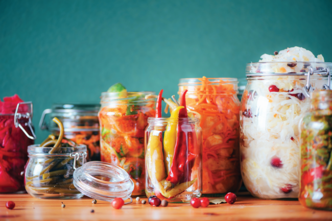 Variety of fermented foods in glass jars