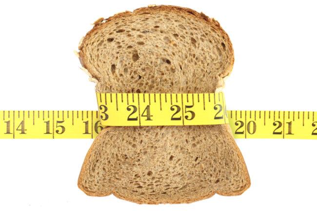 Whole grain bread and measuring tape