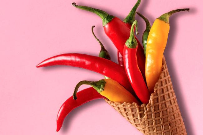 Ice cream cone full of chili peppers